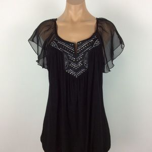 Black blouse with sheer cap sleeves and silver
